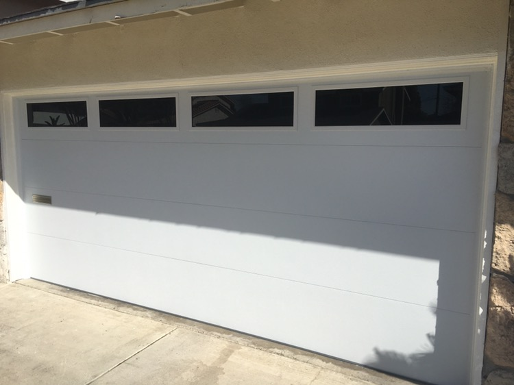 Door With Tinted Windows And A Mail Slot Cut In. Emergency After Hours Garage  Door ...
