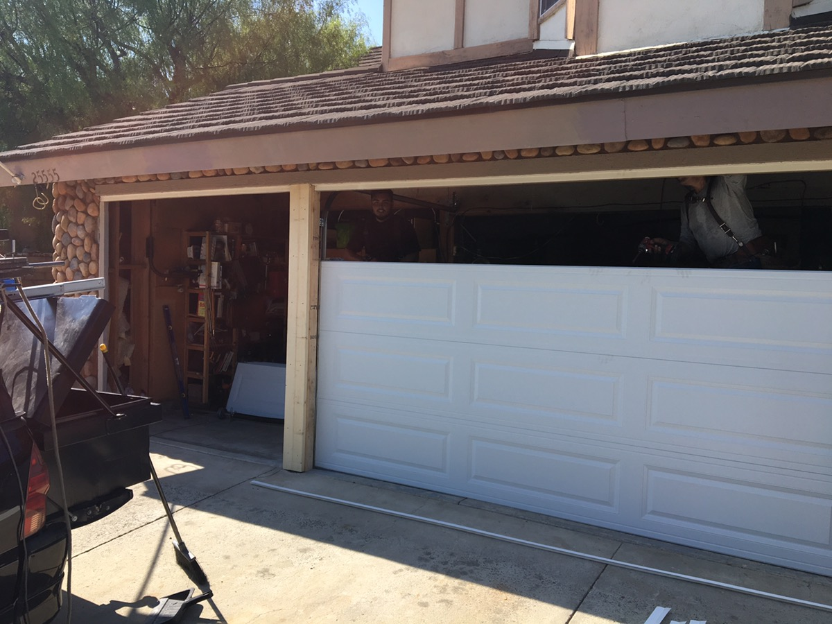 Frame rebuild and new doors in lake forest cityscape for Garage door repair lake forest